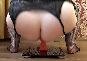 Mature bbw masturbates with a rubber dick back a cowgirl pose, appetizing booty shaking.