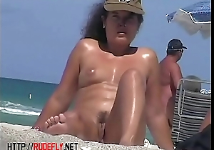 Hot blondie in the nude beach voyeur video